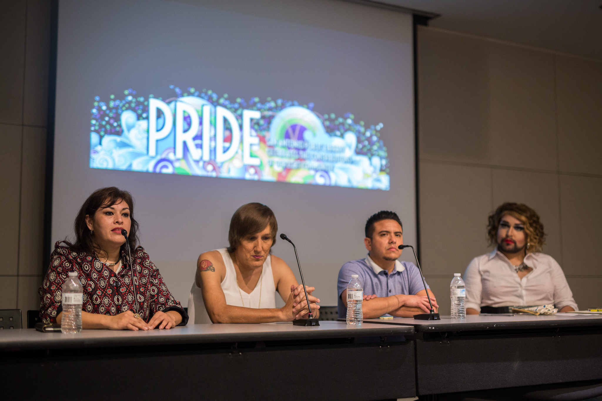 Panelists (left to right) Alejandra Galindo-Cantu, Ashleigh Brown, Erick Macias along with moderator Foxxy Blue Orchid discuss coming out at the San Antonio Central Library. Photo by Scott Ball.