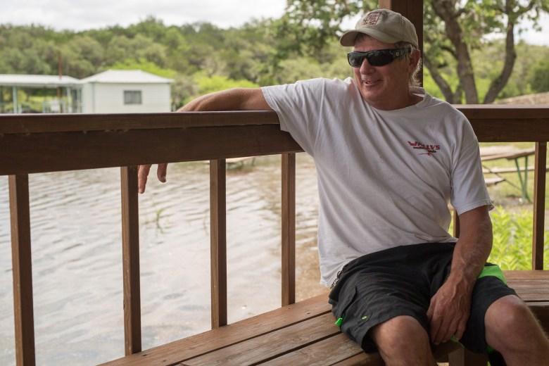 Mike Crandall, owner of Wallys Watersports, sits alongside Medina Lake.  Photo by Scott Ball.