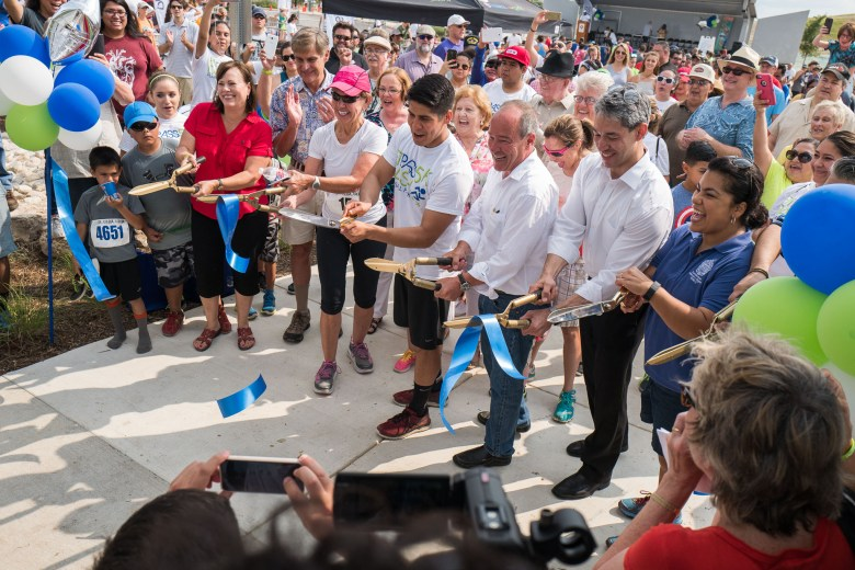 City staff along with lead Project Design Consultant Larry Clark cut the ribbon officially opening Pearsall Park. Photo by Scott Ball.