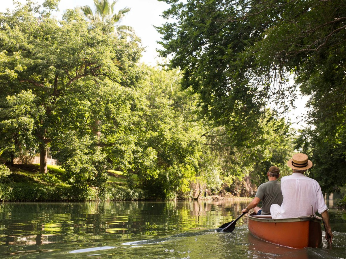 Mike Casey and Peter Grojean paddle a canoe North on the San Antonio River. Photo by Scott Ball.
