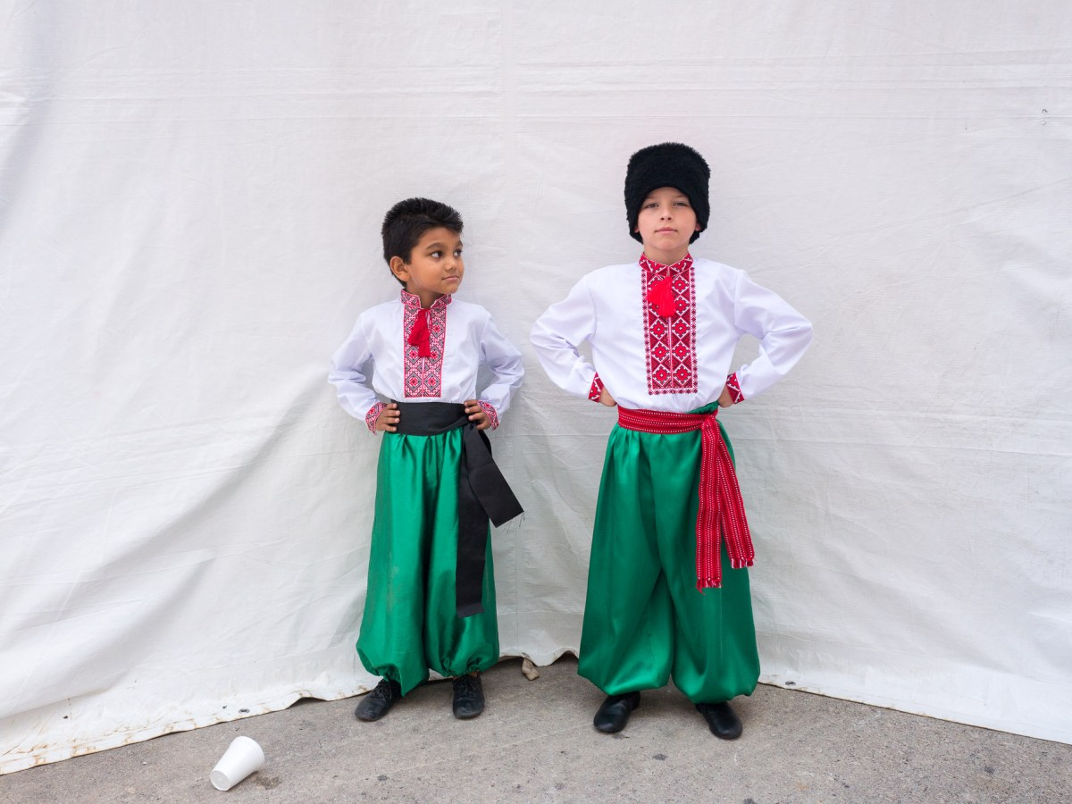 Dancers (left) Vedant, 5, and Alex, 8, pose for a photograph in front of a dressing tent before they perform. Photo by Scott Ball.