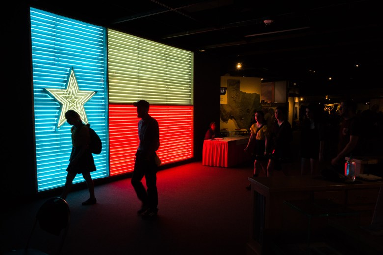 A large neon Texas Flag is displayed prominently inside the Institute of Texan Cultures. Photo by Scott Ball.