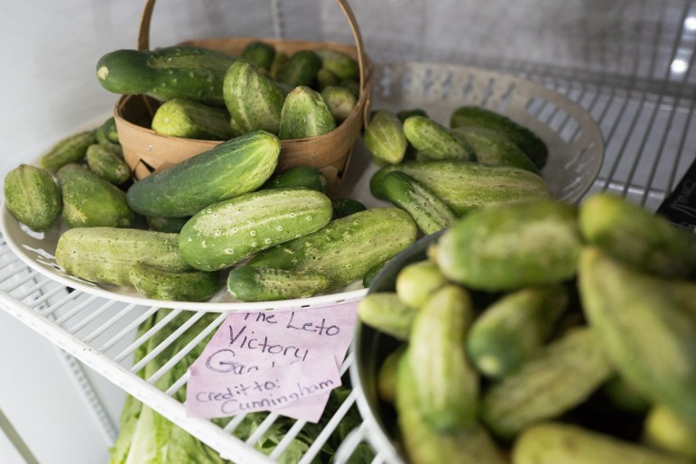 Cucumbers and assorted vegetables are kept cool and fresh for customers. Photo by Scott Ball.