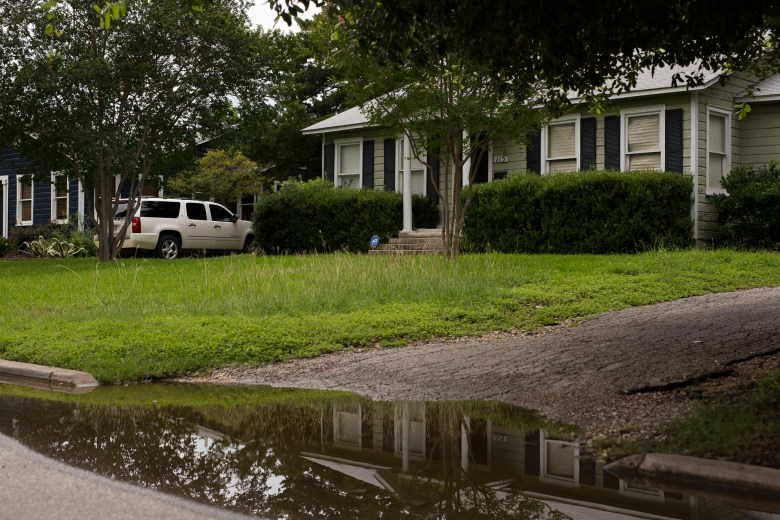 Water collects along the driveway of a residence in the Terrell Hill neighborhood. Photo by Scott Ball.
