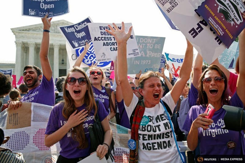 Demonstrators celebrated at the U.S. Supreme Court on June 27, 2016, after the court struck down a Texas law imposing strict abortion regulations. Photo by Kevin Lamarque for REUTERS.
