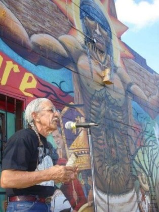 """Poet Raúl Salinas at the """"Seeds of Solidarity"""" mural blessing. Photo courtesy of Maria Ines Rodriguez."""