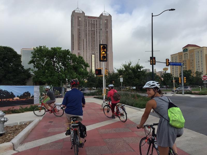 Elena Studier & Co. ride through the new Market Street bike path. Photo by Robert Rivard.