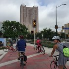 Elena Studier & Co. ride through the new Market Street bike path. Photo by Robert Rivard.