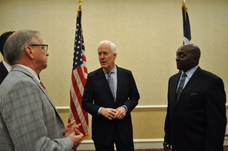 U.S Sen. John Cornyn (R-Texas) speaks with Crosspoint President and CEO Kevin Downey (left) and Pastor Raymond Bryant of Bethel AME Church. Photo by Iris Dimmick.