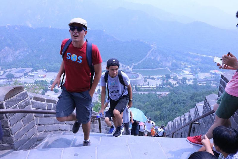 Gabriel Samandi and Jeffrey Garcia climb the Great Wall of China in July of 2016. Photo courtesy of Summer of Service.
