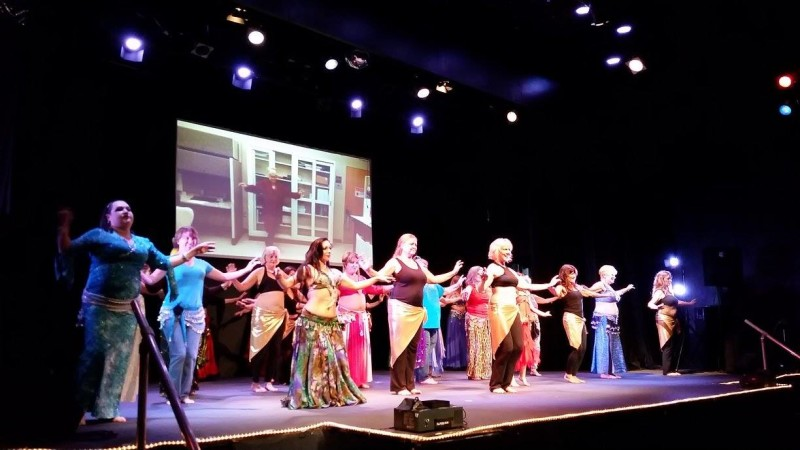 The ensemble performs alongside a video submission from international students. Photo courtesy of Kathy Swanson.