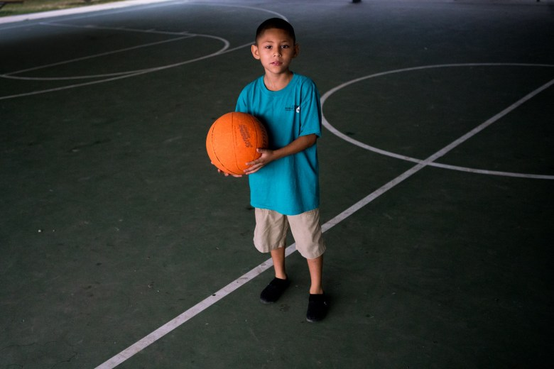 Izaiah plays basketball after the morning activity.  Photo by Kathryn Boyd-Batstone.