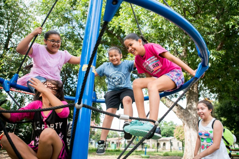 From left bottom: Valerie, Sabrina, Jessica, Evelynn, Ruby play on the jungle gym at Good Sam. Photo by Kathryn Boyd-Batstone.