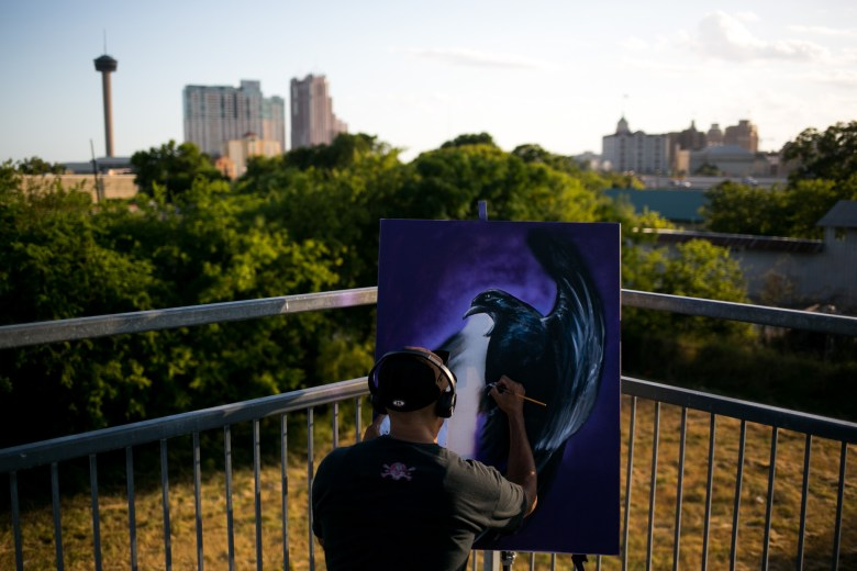 San Antonio artist Paul Garson paints on the Hays Street Bridge. Photo by Kathryn Boyd-Batstone.
