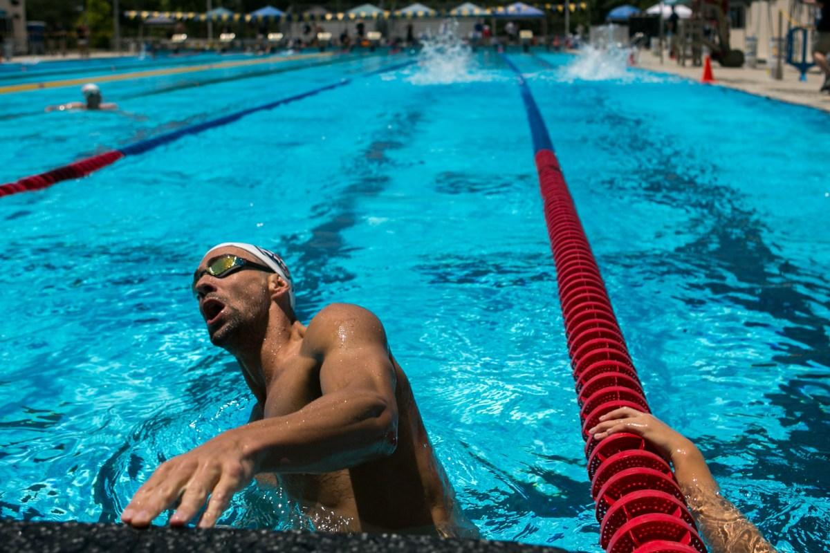 Olympic swimmer Michael Phelps starts off another set of laps. Photo by Kathryn Boyd-Batstone.