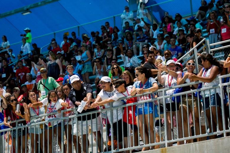 Fans reach for a 2016 U.S. Olympic Swimming Team shirt. Photo by Kathryn Boyd-Batstone.