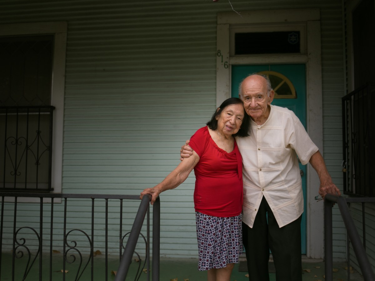 Isabel and Enrique Sanchez stand in front of Casa de Cuentos one of their many properties dedicated for community gathering. Photo by Kathryn Boyd-Batstone.
