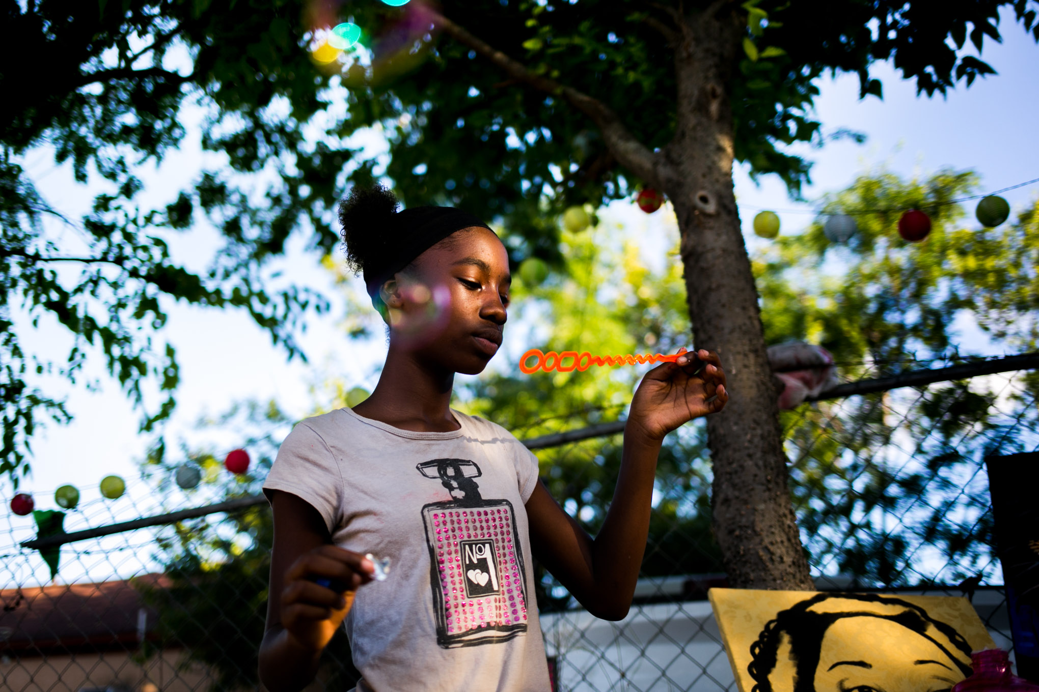 Breonna plays with bubbles at Gardopia's one-year anniversary party. Photo by Kathryn Boyd-Batstone.