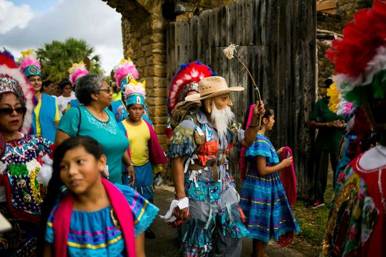 Matachines dancers enter Mission San Juan after the Pilgrimage. Photo by Kathryn Boyd-Batstone.
