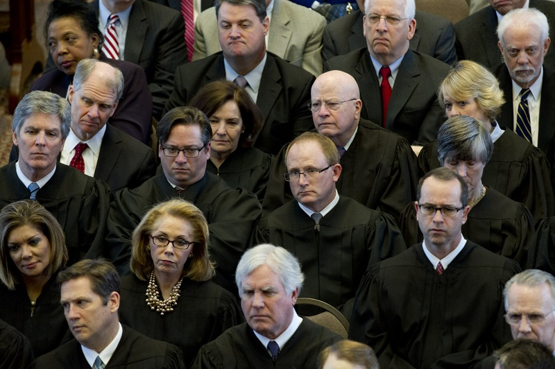 Texas Supreme Court and Court of Criminal Appeals justices listen to Chief Justice Nathan Hecht's State of the Judiciary speech to legislators on Feb. 18, 2015. Photo by Bob Daemmrich for the Texas Tribune.