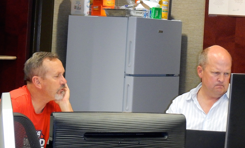 San Antonio lawyer Mikal Watts (right) and Mike McCrum prepare for the federal trial in which Watts will act as his own legal counsel in a Gulfport, Miss. conference room. Photo courtesy of Mikal Watts.