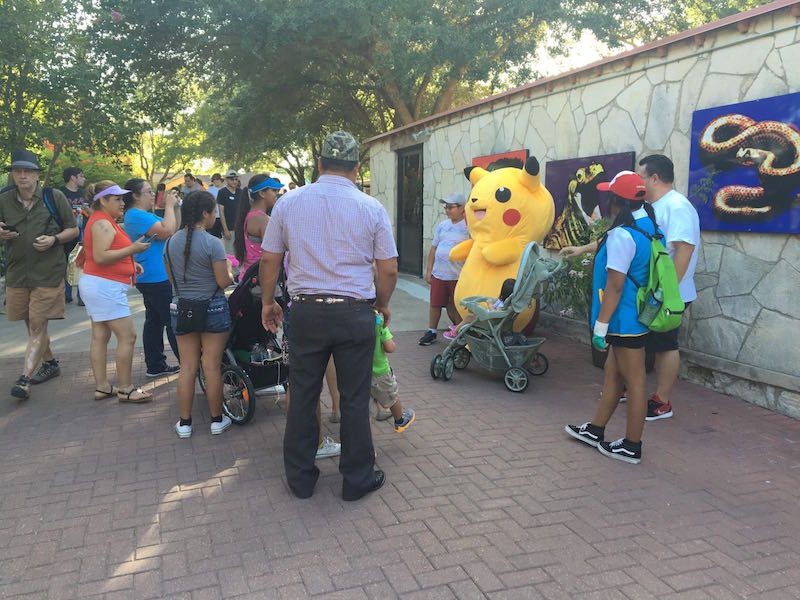 Children take pictures with a lifesize Pikachu character. Photo courtesy of the San Antonio Zoo.
