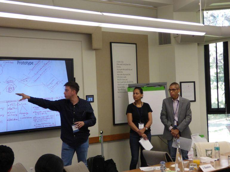 Alberto Altamirano, Monique Garcia, and Miguel Blancarte present their group's initiative on connecting and engaging Latino millennials. Photo courtesy of Alberto Altamirano.