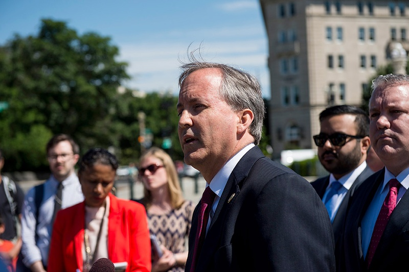 Texas Attorney General Ken Paxton holds a press conference on June 9, 2016 in front of the U.S. Supreme Court to discuss the filing of a lawsuit against the state of Delaware. Photo by Bill Clark for The Texas Tribune.