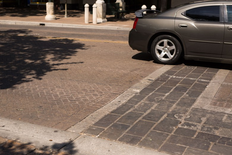 What many view as a crosswalk across Alamo Street actually is a paver demonstration of the approximate original boundaries of the Alamo grounds. Photo by Scott Ball.