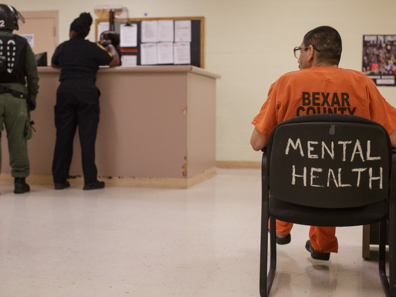 An inmate at the Bexar County Adult Detention Center sits in the mental health unit.