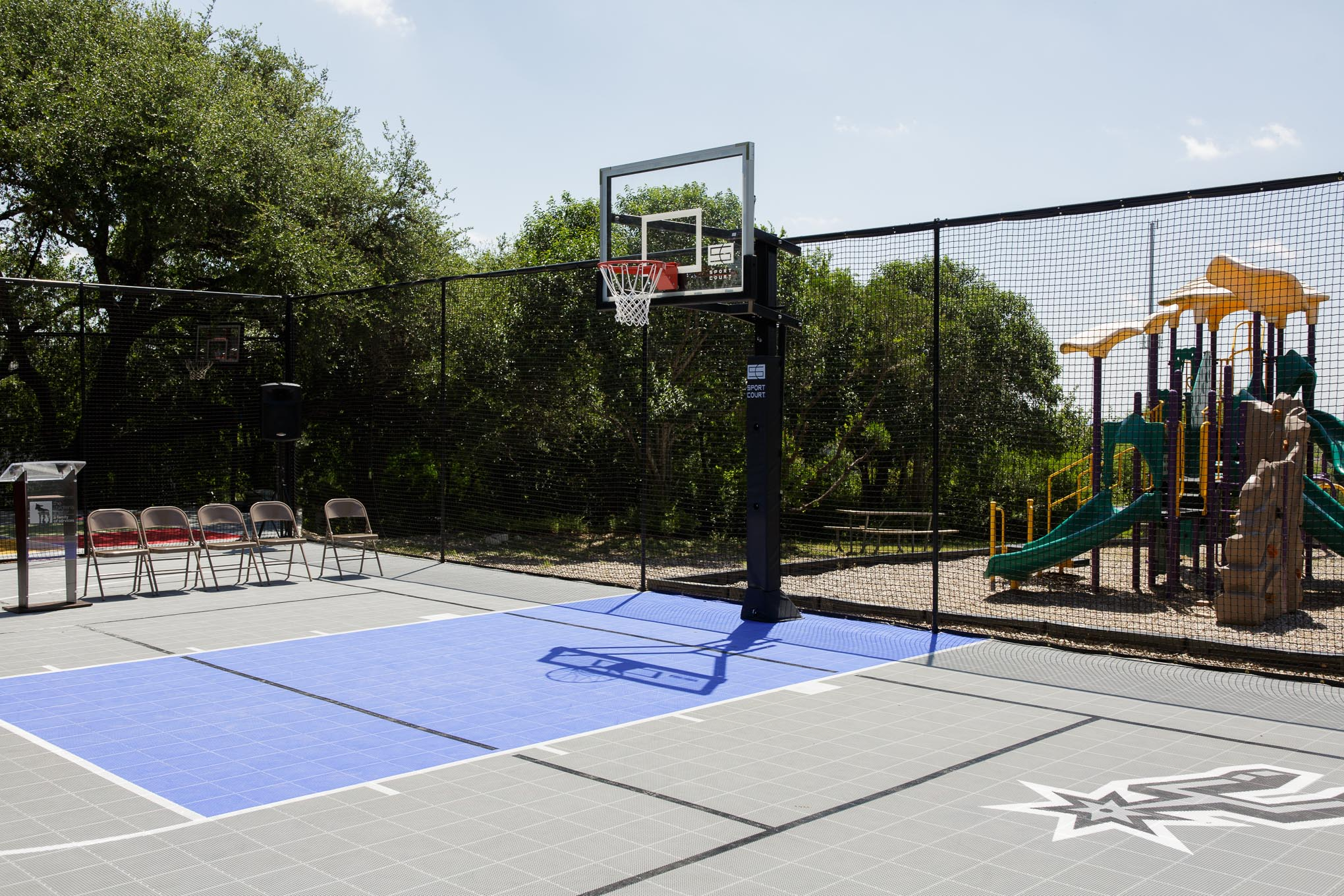 The new basketball court at the Children's Shelter Residential Treatment Center is adorned with the Spurs logo. Photo by Scott Ball.