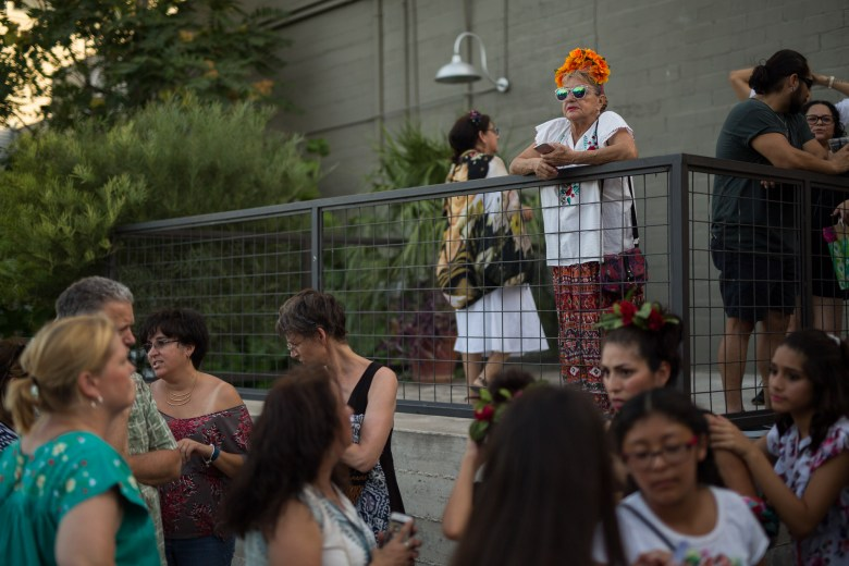 Maya Rodriguez (top center) dressed like Frida overlooks the crowd and long line waiting to enter Brick. Photo by Scott Ball.