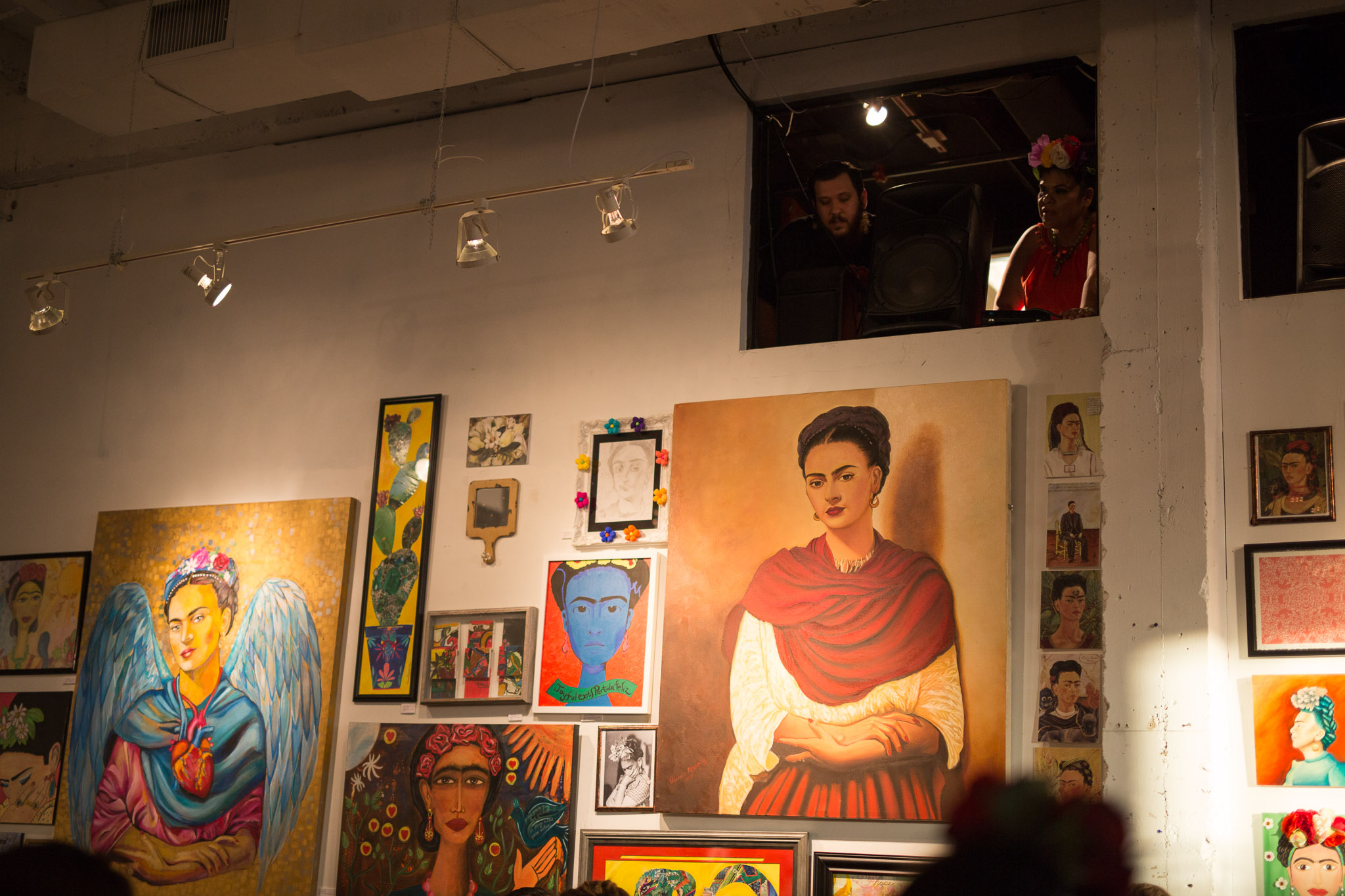 Paintings of Frida Kahlo adorn the walls of Brick at Blue Star Arts Complex. Photo by Scott Ball.
