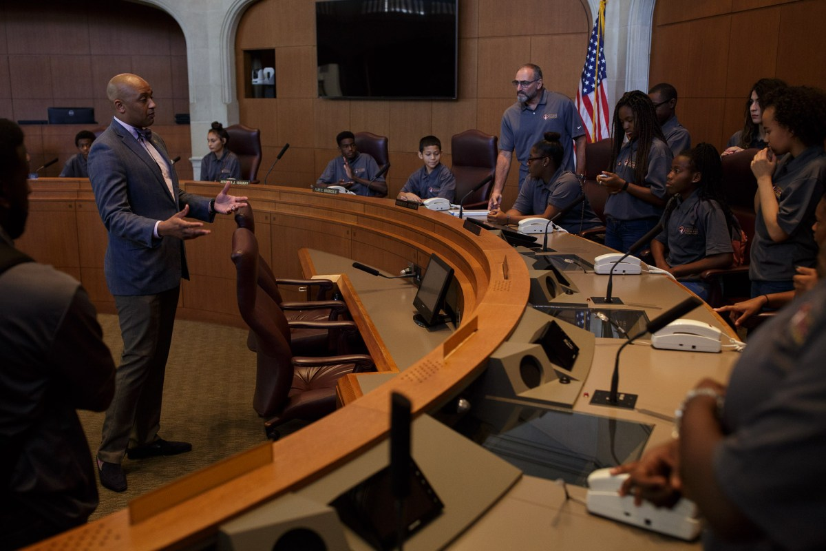 Councilman Alan Warrick (D2) speaks to the Eastside Dreamers Academy at City Council chambers. Photo by Scott Ball.