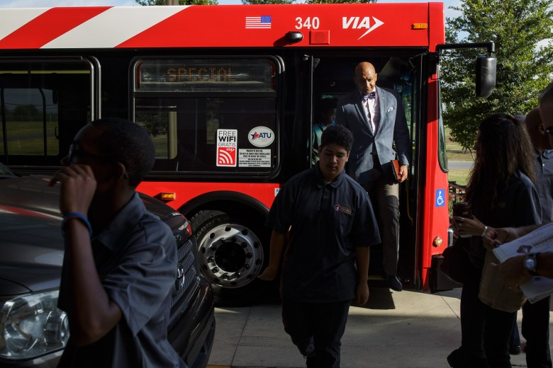 Councilman Alan Warrick exits the VIA bus upon arrival to Toyota Motor Manufacturing. Photo by Scott Ball.