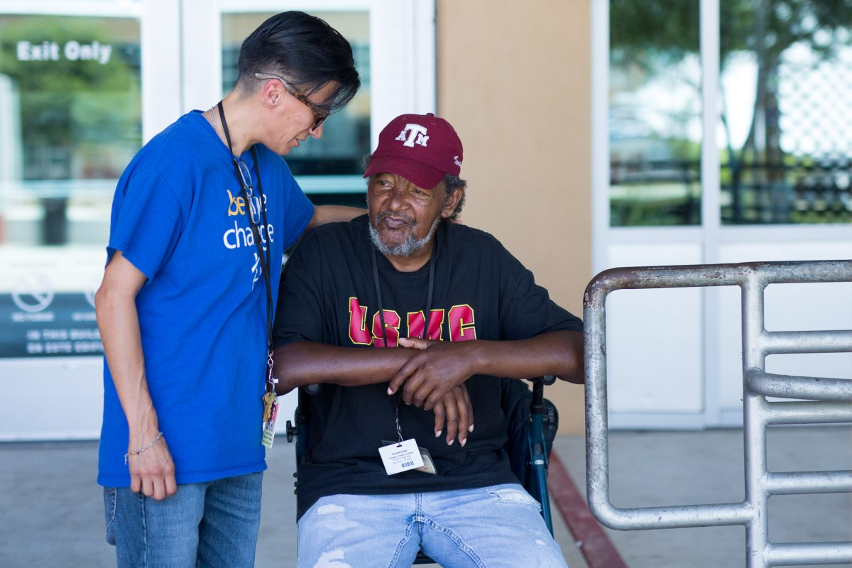 Lamanda Del Toro greets 19 month Haven for Hope resident Kenneth Eanes on campus. Photo by Scott Ball.