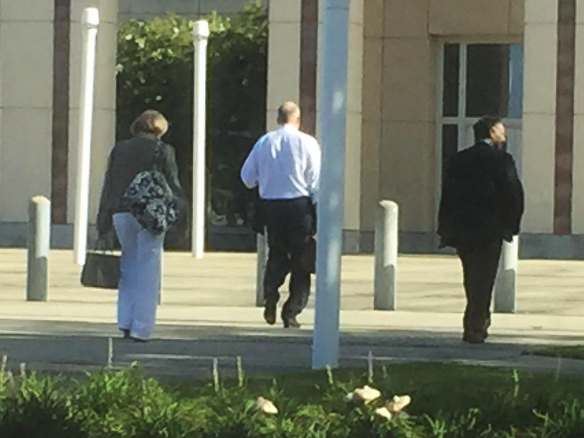 (From left:) Judge Sandra Watts, Mikal Watts, and Judge Terry Shamsie walk into the courthouse in Gulfport, Miss. Photo by Desi Canela.