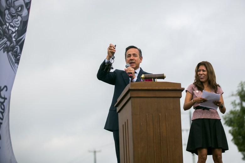 "Senator Carlos Uresti holds up the ""keys to the campus"" as Texas A&M President Dr. Cynthia Teniente-Matson watches. Photo by Kathryn Boyd-Batstone."