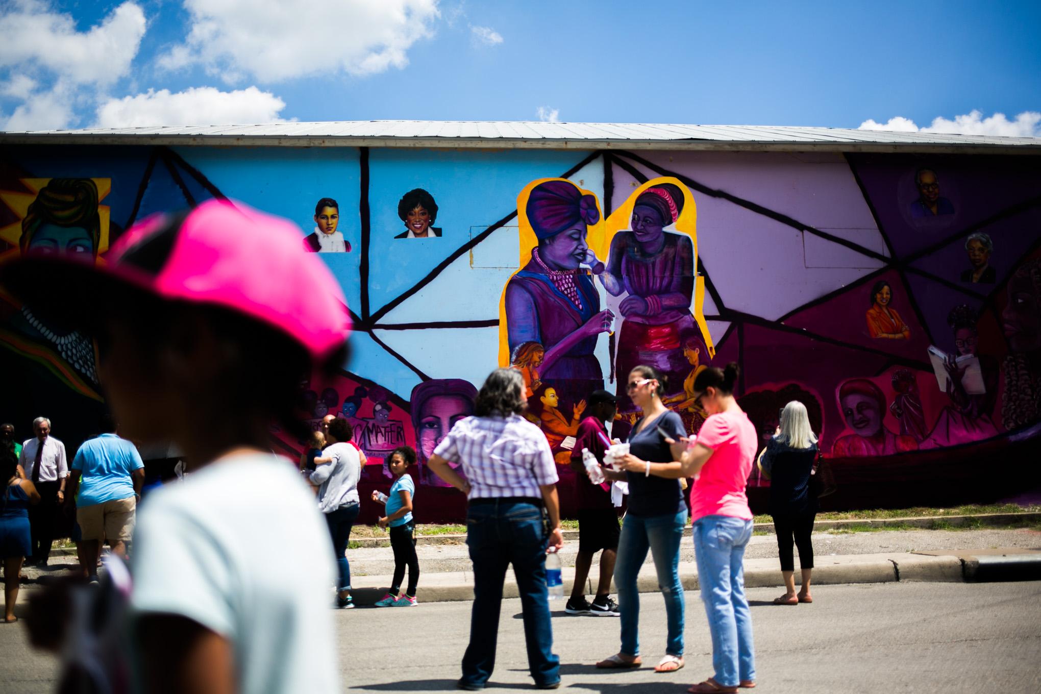 The mural is on 2603 E. Houston St. and features women like Ethel Minor, Ella Austin, Ruth Jones McClendon, Mayor Ivy Taylor, Artemisia Bowden, and Myra Davis Hemmings. Photo by Kathryn Boyd-Batstone.