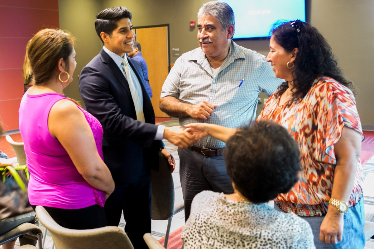 Councilman Rey Saldaña (D4) greets families at the South San Kids First town hall. Photo by Kathryn Boyd-Batstone.