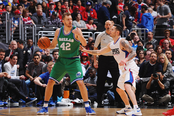 David Lee #42 of the Dallas Mavericks defends the ball against the Los Angeles Clippers during the game on April 10, 2016 at STAPLES Center in Los Angeles, California. Photo by Juan Ocampo/NBAE via Getty Images.
