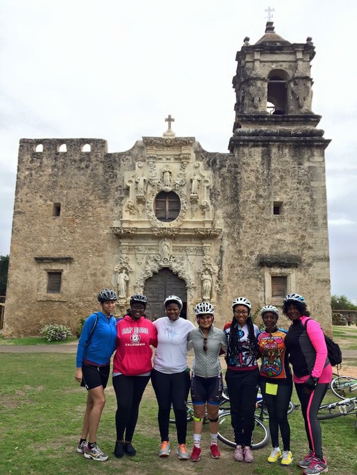 Black Girls Do Bike participants pose for a photo in front of Mission San José. Photo courtesy of Tamisha Johnson.