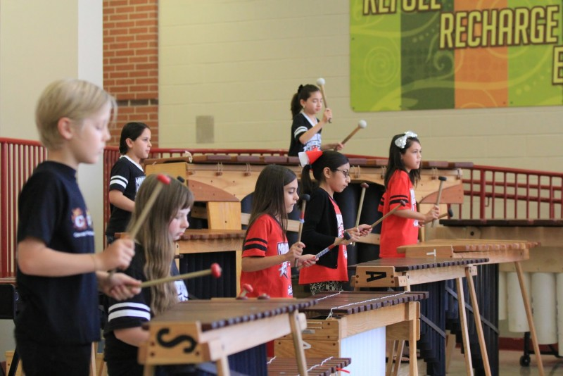 Bonnie Anderson's students play the marimbas in class. Photo by Javier Duran.
