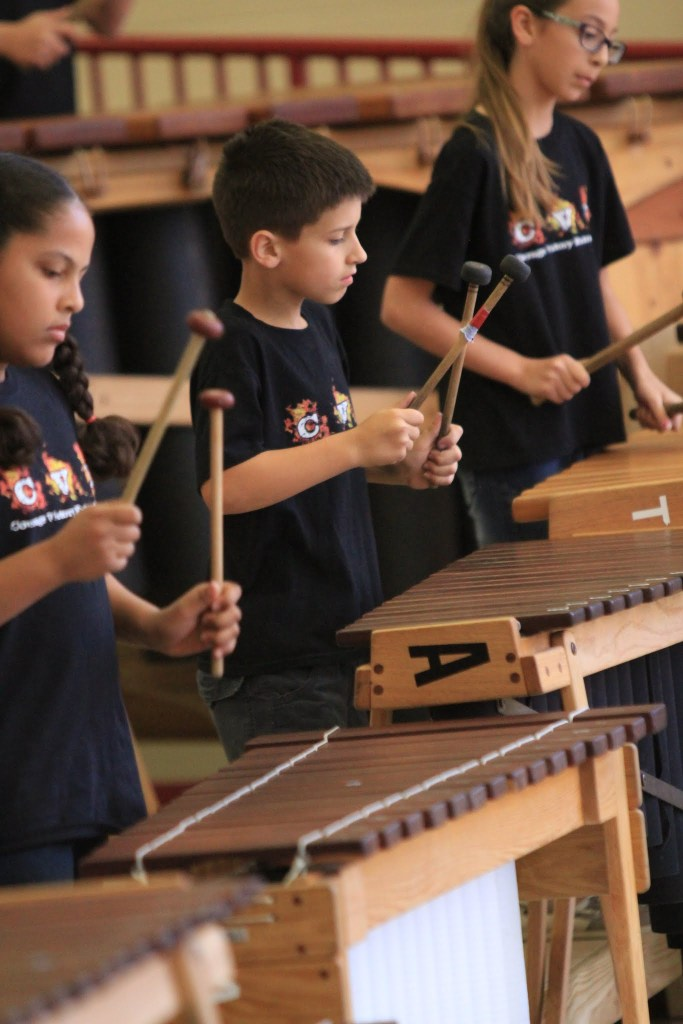 Three of Bonnie Anderson's students play the marimbas in class. Photo by Javier Duran.