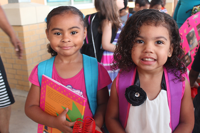 Two students enjoy free book giveaways at last years SA Kids Attend to Win kick off. Photo courtesy of P16Plus.