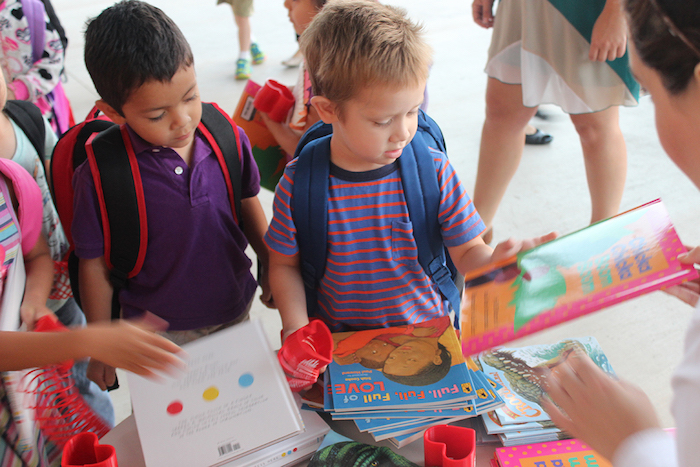 Kids look through free books during an SA Kids Attend to Win campaign kickoff.
