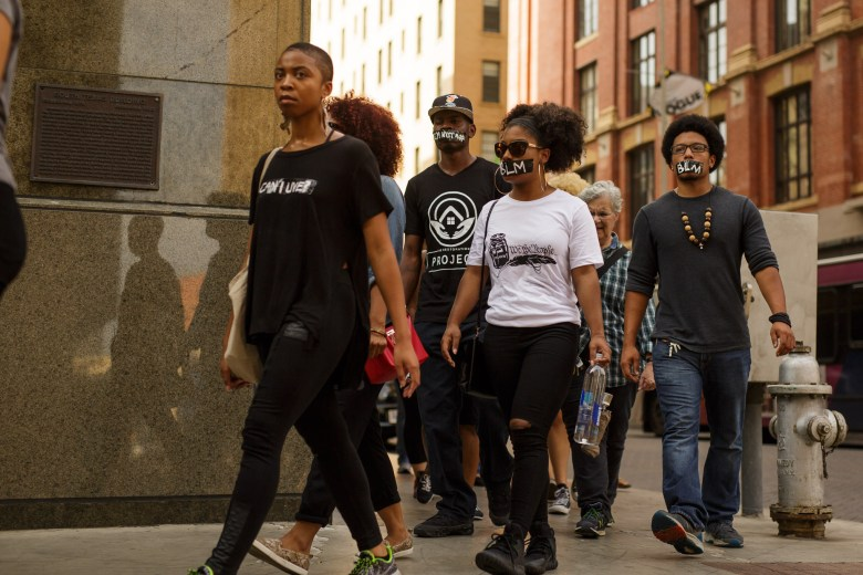 Local #BlackLivesMatter activists walk onto Houston Street during a silent protest. Photo by Scott Ball.