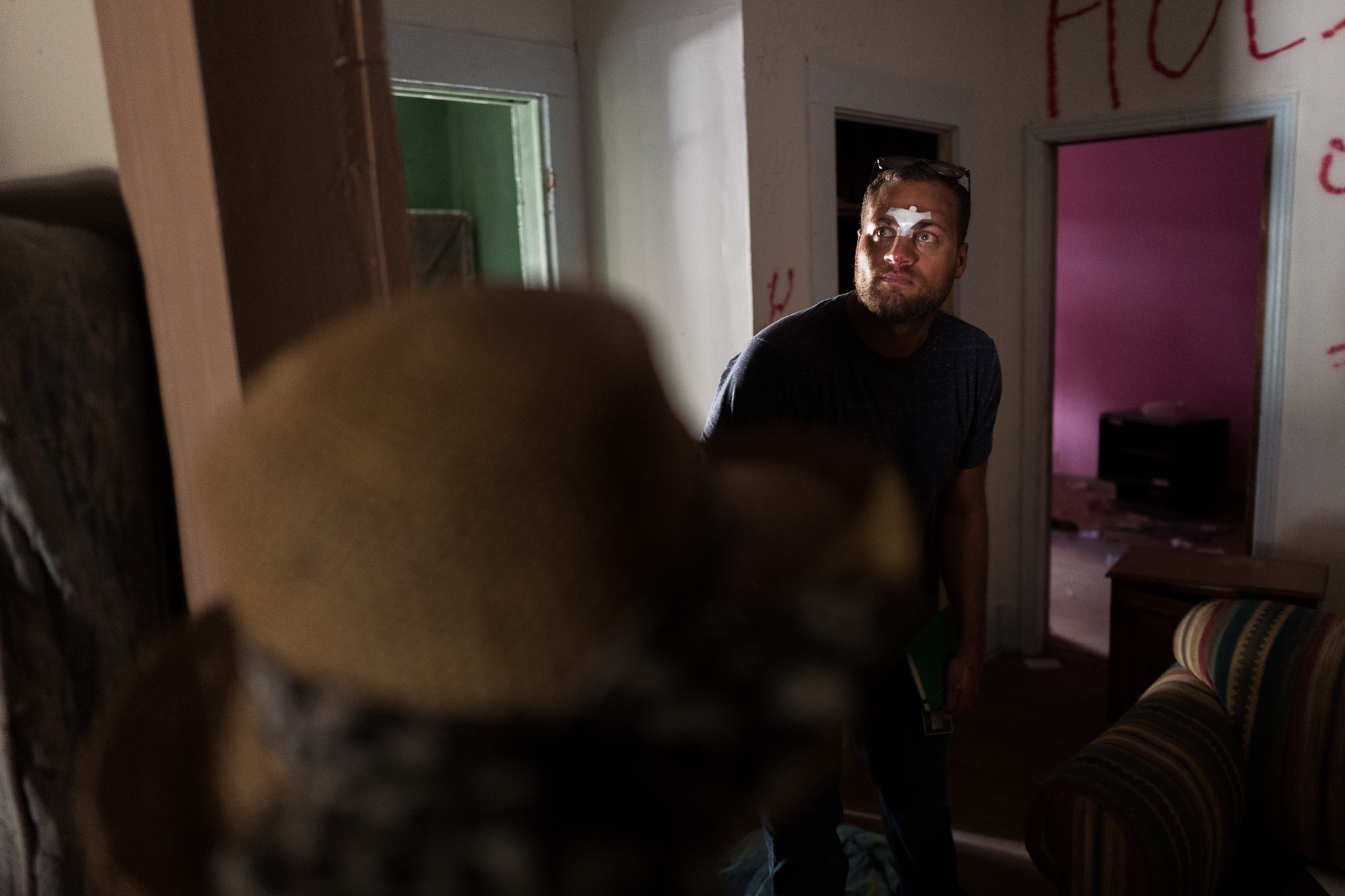 Brian Dillard walks through his grandparents old home which was directly across the street from his childhood house on Lamar Street. Photo by Scott Ball.