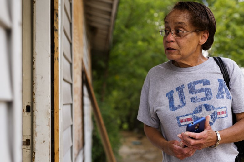 Cynthia Dillard looks inside of the home in which she raised her son Brian in for the last time. Photo by Scott Ball.