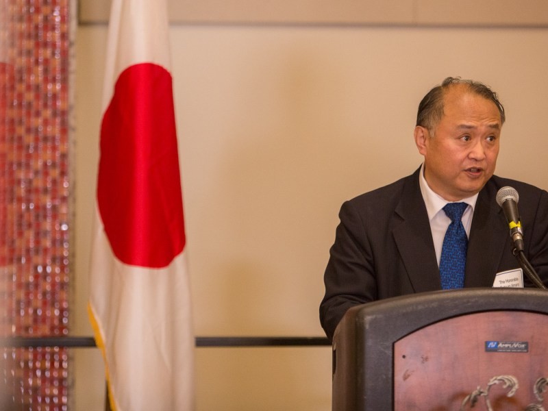 Japanese Consul General Tetsuro Amano addresses the crowd and discusses the funding effort for Kumamoto. Photo by Scott Ball.